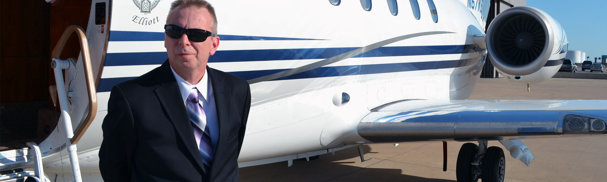 Mark next to a private jet